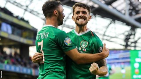 Robbie Brady celebrates his goal with Enda Stevens