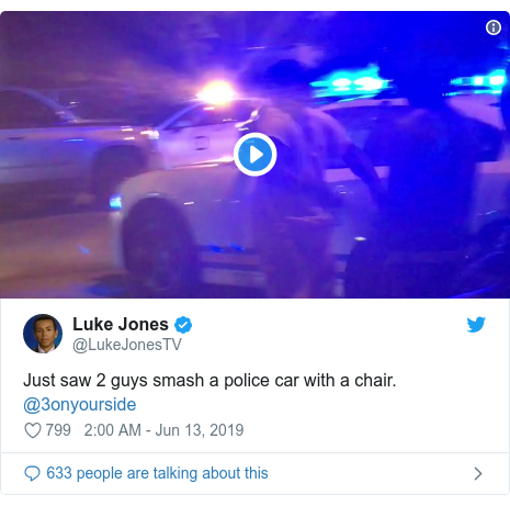Twitter post by @LukeJonesTV: Just saw 2 guys smash a police car with a chair. @3onyourside