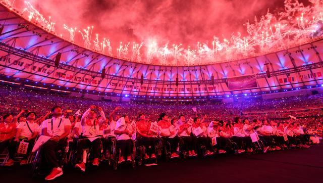 Japanese athletes watch the show during the closing ceremony of the Rio 2016 Paralympic Games