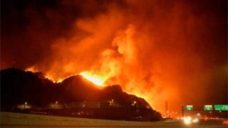 Wildfire burns in the Sylmar neighbourhood of Los Angeles