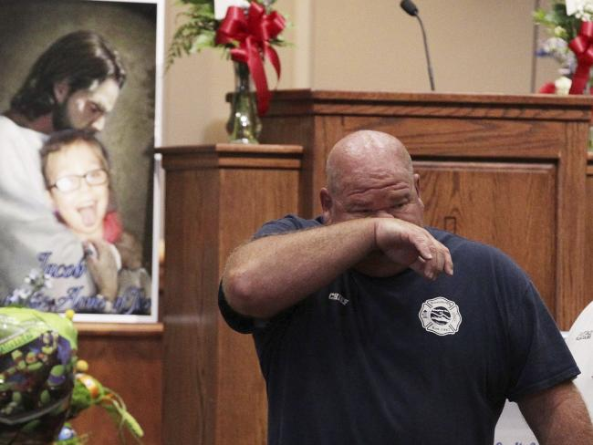 Townville Fire Chief Billy McAdams wipes tears away from his face. Picture: Ken Ruinard/The Independent-Mail via AP