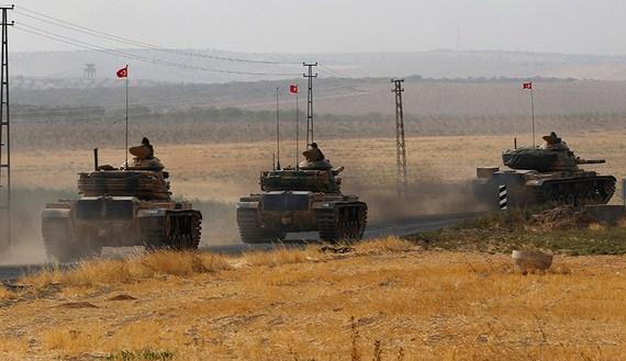 Turkish army tanks drive towards to the border in Karkamis on the Turkish Syrian border in the southeastern Gaziantep province Turkey