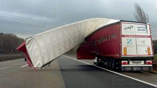 A truck's tarpaulin is blown off on to the motorway due to strong winds near Wuppertal, Germany