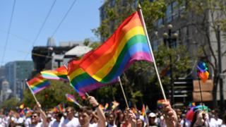 Marchers wave Gay Pride flag during the 2018 San Francisco Pride Parade on June 24, 2018 in San Francisco, California