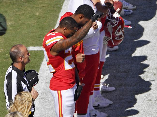 Kansas City Chiefs cornerback Marcus Peters raises his fist in the air during the national anthem before an NFL football game against the San Diego Chargers on Sunday, September 11, 2016, in Kansas City. Picture: John Sleezer / The Kansas City Star via AP