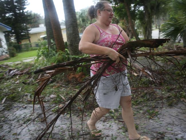 Florida resident Marilyn Whaley cleans up after Hurricane Matthew passed through the area. Picture: Joe Raedle/Getty Images/AFP