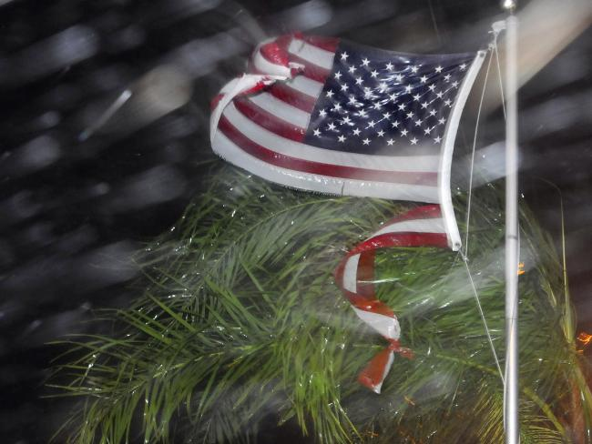 An American flag is ripped to shreds from heavy rain and wind from Hurricane Matthew. Picture: Craig Rubadoux/Florida Today via AP