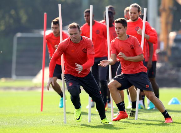 Wayne Rooney left will not feature in the Europa League despite training with the squad