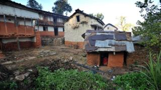 In this file photo taken on November 23, 2011 a Nepali teenage girl sits inside a chhaupadi house in Achham village, some 800km west of Kathmandu,