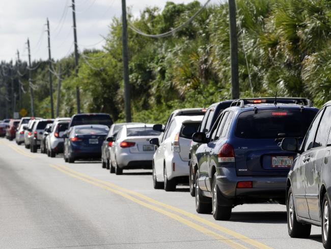 Brevard County residents line up for sandbags in preparation for the storm. The line stretched for almost 10km and the wait was around two hours for the bags, Brevard County Sheriffs said Picture: John Raoux