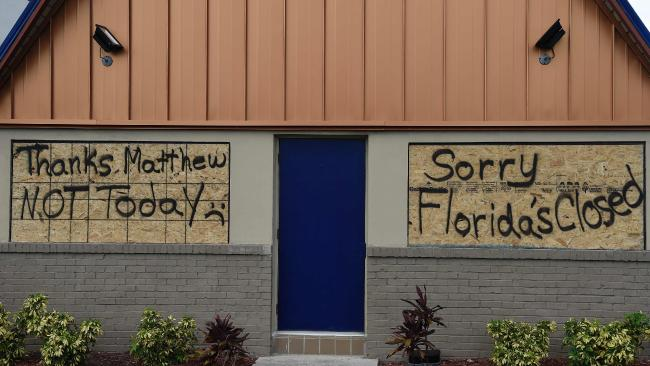 A boarded up IHOP restaurant has messages to Hurricane Matthew written on the plywood as it sits closed ahead of the storm which is expected to hit soon. Picture: Rhonda Wise