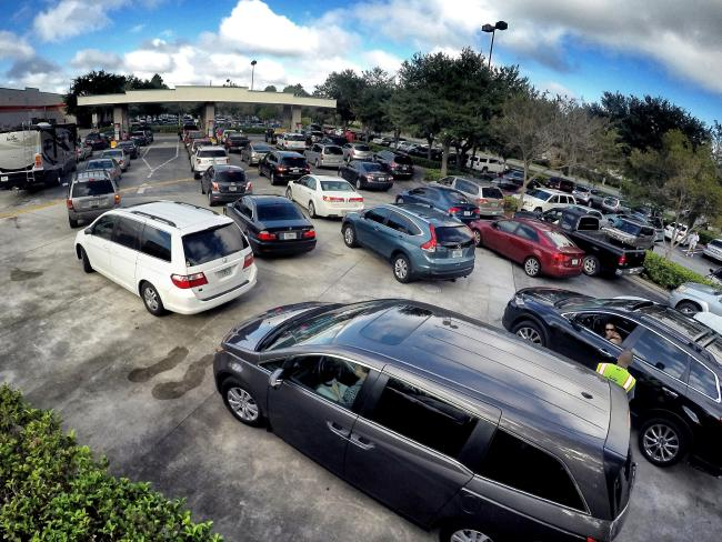 Long lines for petrol can be seen at the Costco store in Altamonte Springs, Florida as people prepare for the anticipated strike of Hurricane Matthew. Picture: Joe Burbank/Orlando Sentinel via AP