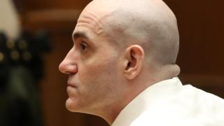 Michael Gargiulo, with a cleanly shaved bald head, is seen in a close-up profile in this court photo