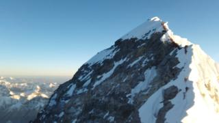 Climbers are seen on 22 May approaching summit