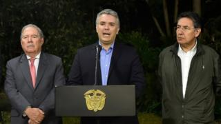 Colombian President Ivan Duque (C) speaks next to Colombian Defence Minister Guillermo Botero (L) and Attorney General Nestor Humberto Martinez (R)