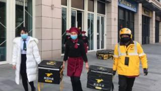 Hospital staff carrying food