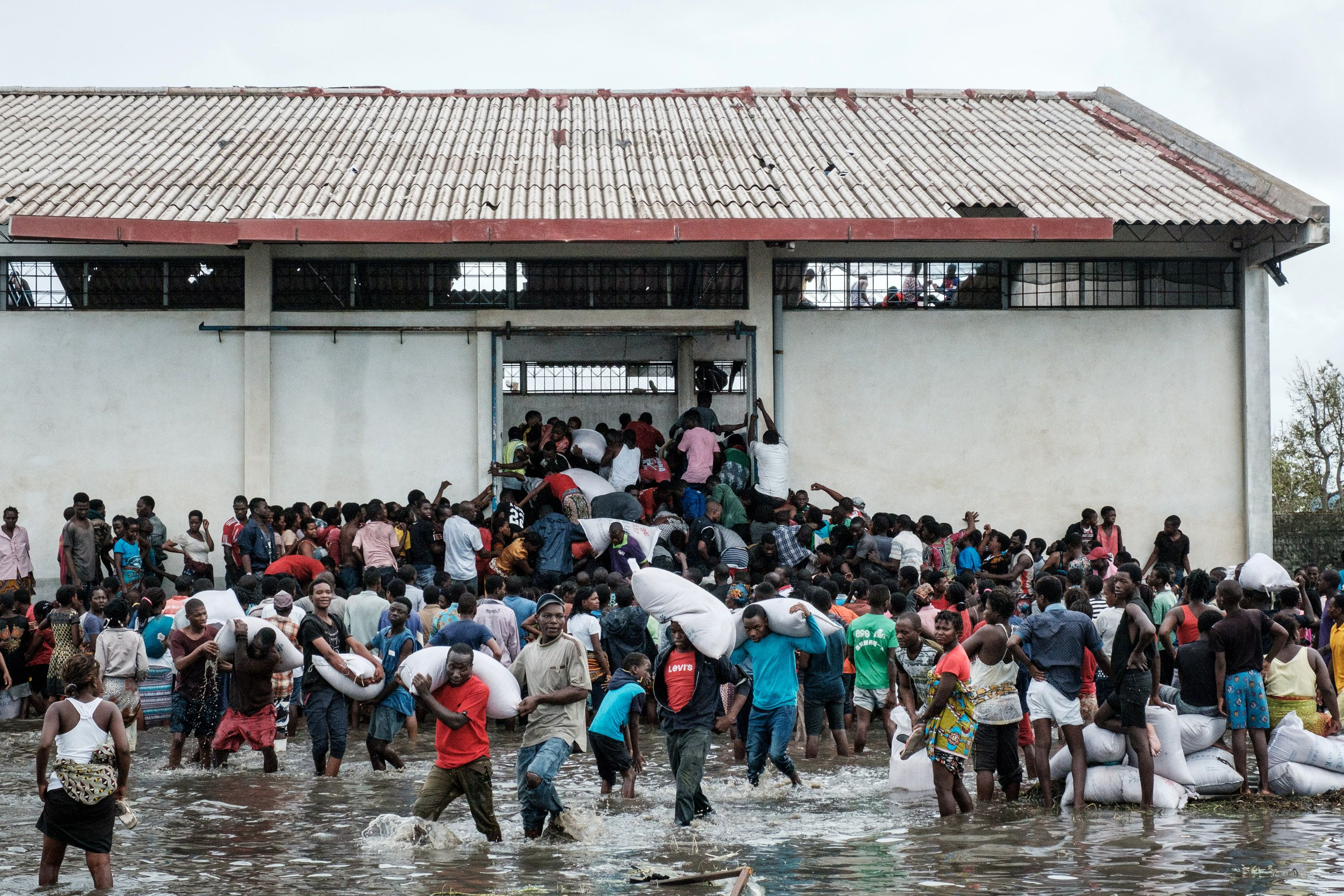 Survivors try to access aid in the wake of Cyclone Idai
