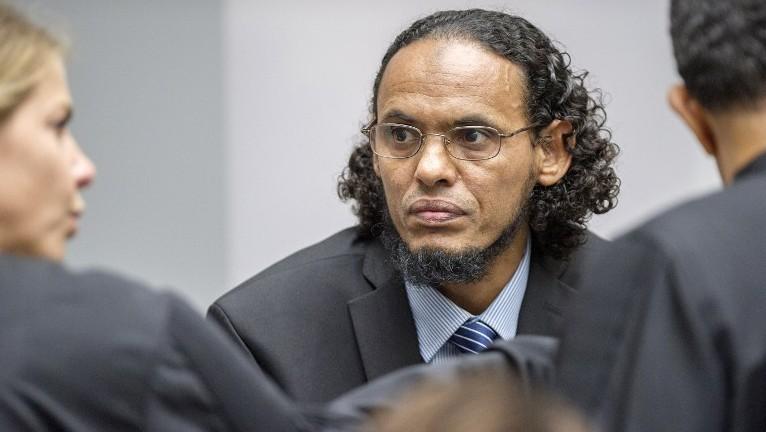 Alleged Al Qaeda-linked Islamist leader Ahmad Al Faqi Al Mahdi center looks on during an appearance at the International Criminal Court in The Hague