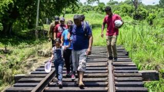 Central Americans migrants heading the US, walk by a breach trying not be detected by Mexican migration authorities at outskirt of Huixtla, Chiapas state, Mexico, on June 9, 2019.