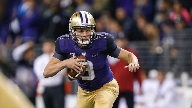 Washington Huskies quarterback Jake Browning avoids the rush by the Stanford Cardinals on Friday in Seattle. Jennifer Buchanan  USA Today Sports
