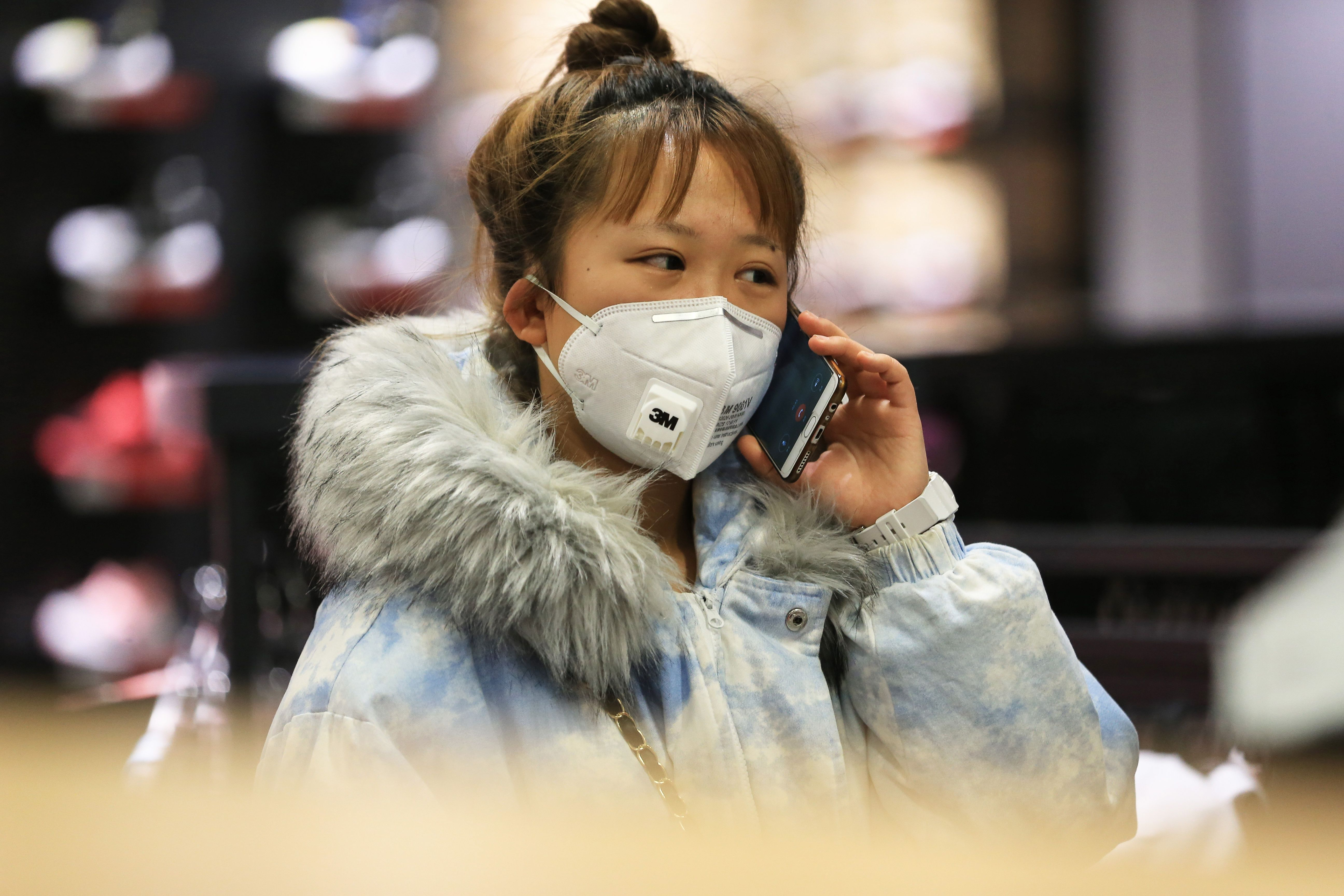 A Chinese woman in a shopping mall in Shenyang wears a face mask.