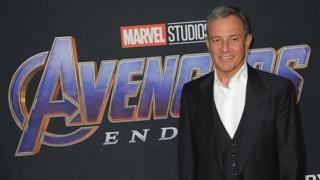 Bob Iger in front of Avengers: Endgame logo
