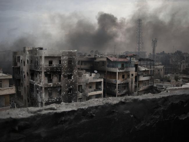 Smoke rises over Saif Al Dawla district, in Aleppo, Syria. Picture: Manu Brabo/AP