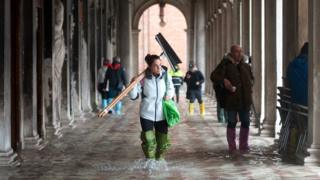 St Mark's Square in Venice is flooded in water during an exceptional high tide, 13 November 2019