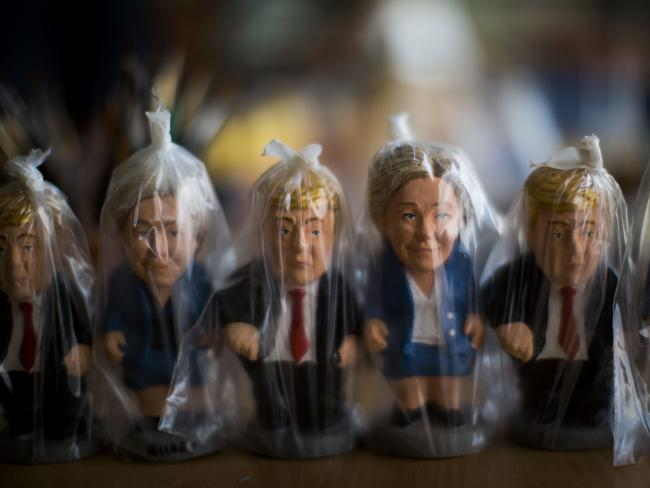 Miniatures of US presidential candidates Hillary Clinton and Donald Trump are wrapped in plastic bags in a factory at Torroella de Montgri, northeast Catalonia, Spain. A curious Christmas tradition in the Spanish autonomous region of Catalonia depicts both candidates in a rather scatological situation. The miniatures depict a person defecating, and traditionally symbolises fertilisation and a source of luck and prosperity in the new year. Picture: AP / Emilio Morenatti
