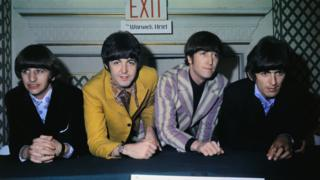 The Beatles are shown the exit door