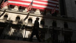 A man walks by the New York Stock Exchange (NYSE) on July 12, 2018 in New York City.