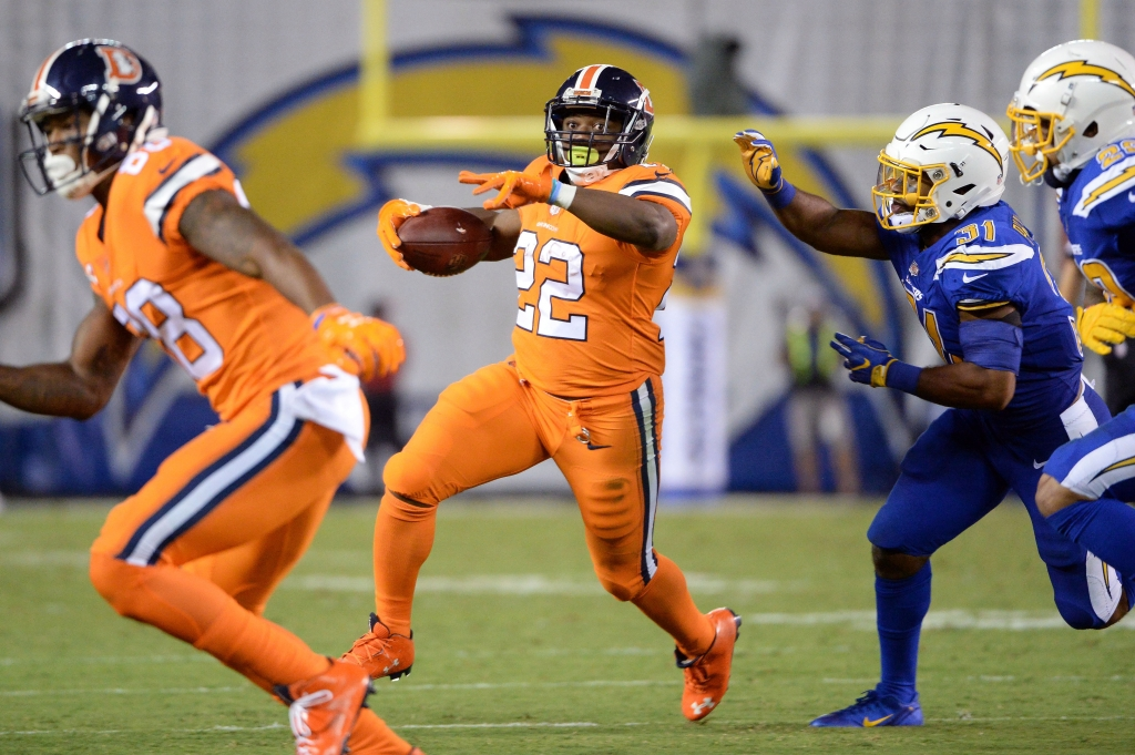 Oct 13 2016 San Diego CA USA Denver Broncos running back C.J. Anderson runs the ball while defended by San Diego Chargers cornerback Adrian Phillips during the second half at Qualcomm Stadium. San Diego won 21-13. Mandatory Credit Orlando