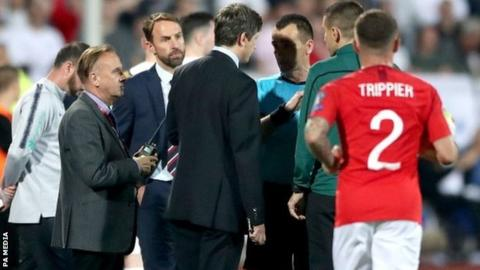 England boss Gareth Southgate speaks to officials during the game in Sofia