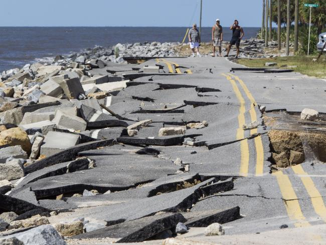 Residents look at Alligator Point road that collapsed during the storm surge from Hurricane Hermine at Alligator Point, Florida. Picture: AFP