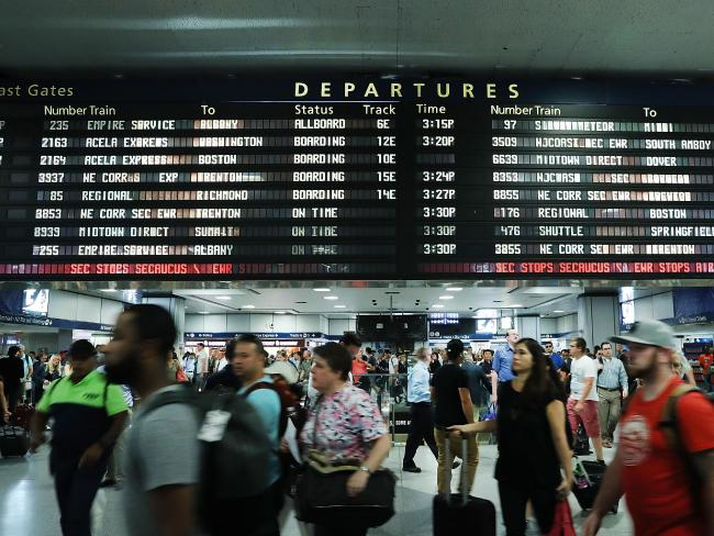 Large crowds rush to depart New York's Pennsylvania station before the start of the Labour Day holiday weekend. Picture: AFP