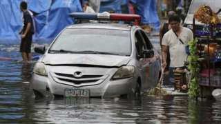 A flooded street in Quezon city, north of Manila. Photo: 26 December 2016