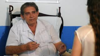 Joao Texeira de Faria sees a patient at his spiritual clinic in Abadiania in 2012
