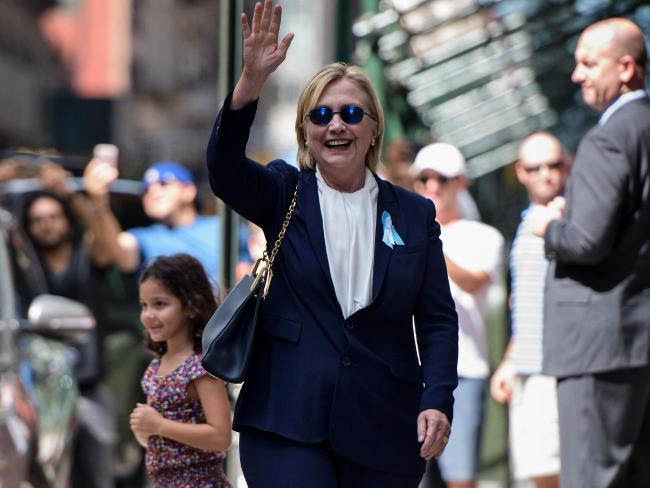 Hillary Clinton waves to onlookers as she leaves her daughter's apartment building after becoming unwell during a September 11 memorial. Picture: AFP/Brendan Smialowski