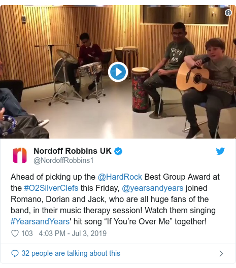 """Twitter post by @NordoffRobbins1: Ahead of picking up the @HardRock Best Group Award at the #O2SilverClefs this Friday, @yearsandyears joined Romano, Dorian and Jack, who are all huge fans of the band, in their music therapy session! Watch them singing #YearsandYears' hit song """"If You're Over Me"""" together!"""