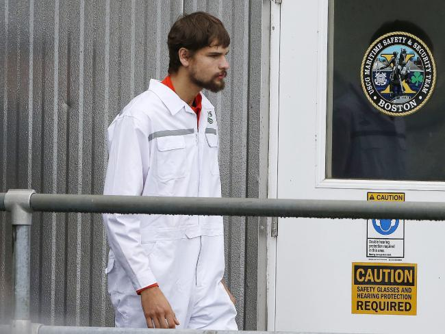 Nathan Carman disembarks at the US Coast Guard station in Boston on September 27, after a week at sea. Picture: Michael Dwyer/AP