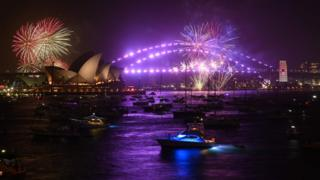 New Years Eve fireworks erupt over Sydneys iconic Harbour Bridge and Opera House during the traditional early family fireworks show, held before the main midnight event, on December 31, 2019