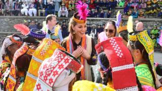The Duchess of Cambridge meets women during a visit to a settlement of the Kalash people in Chitral