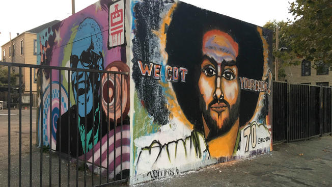 Pendarvis HarshawA muralist with the acronym FLC created a Colin Kaepernick mural at 22nd Street and Telegraph Avenue in Oakland