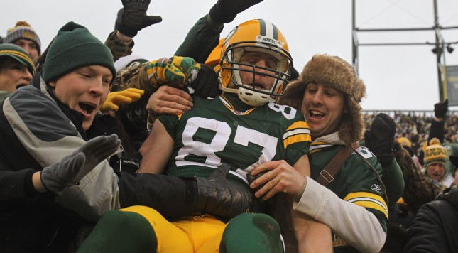 GREEN BAY WI- JANUARY 01 Jordy Nelson #87 of the Green Bay Packers leaps into the stands after scoring a touchdown against the Detroit Lions at Lambeau Field