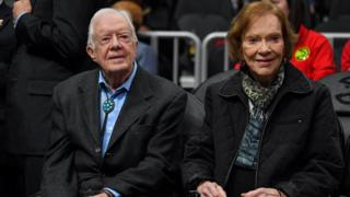 Former US President Jimmy Carter and his wife Rosalynn Carter attend at the game between the Atlanta Hawks and the New York Knicks at State Farm Arena.