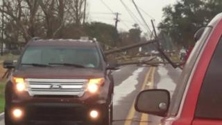 An electricity cable is torn down amid extreme weather in Louisiana