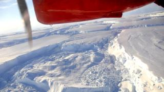 View across Antarctica with part of plane in view