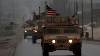 A picture taken on December 30, 2018, shows a line of US military vehicles in Syria's northern city of Manbij