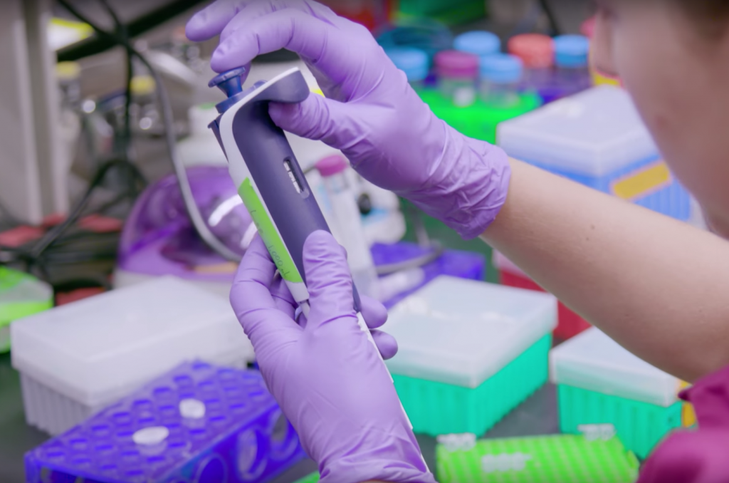 """UW Associate Professor Luis Henrique Ceze in blue and research scientist Lee Organick prepare DNA containing digital data for sequencing which allows them to """"read"""" and retrieve the original files"""