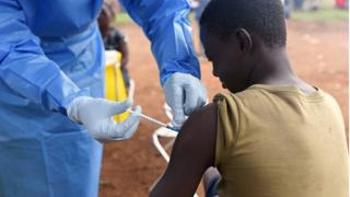 A health worker administers Ebola vaccine to a boy in the village of Mangina in North Kivu province, August 18, 2018